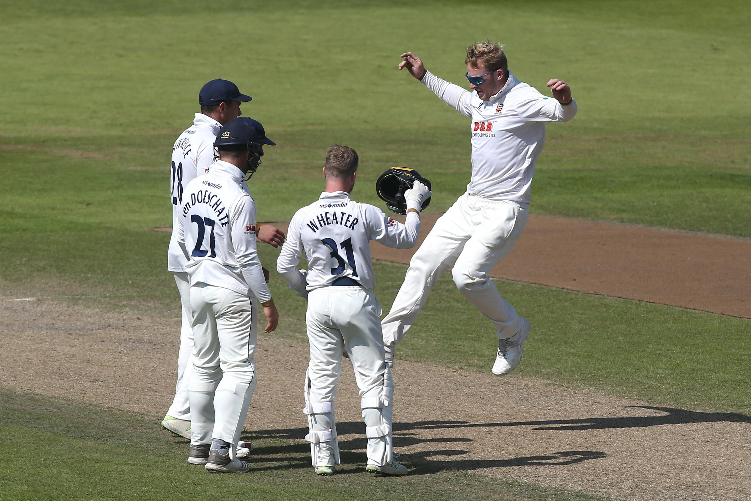 Jump for joy - for Simon Harmer, right, who took four wickets Picture: TGSPHOTO