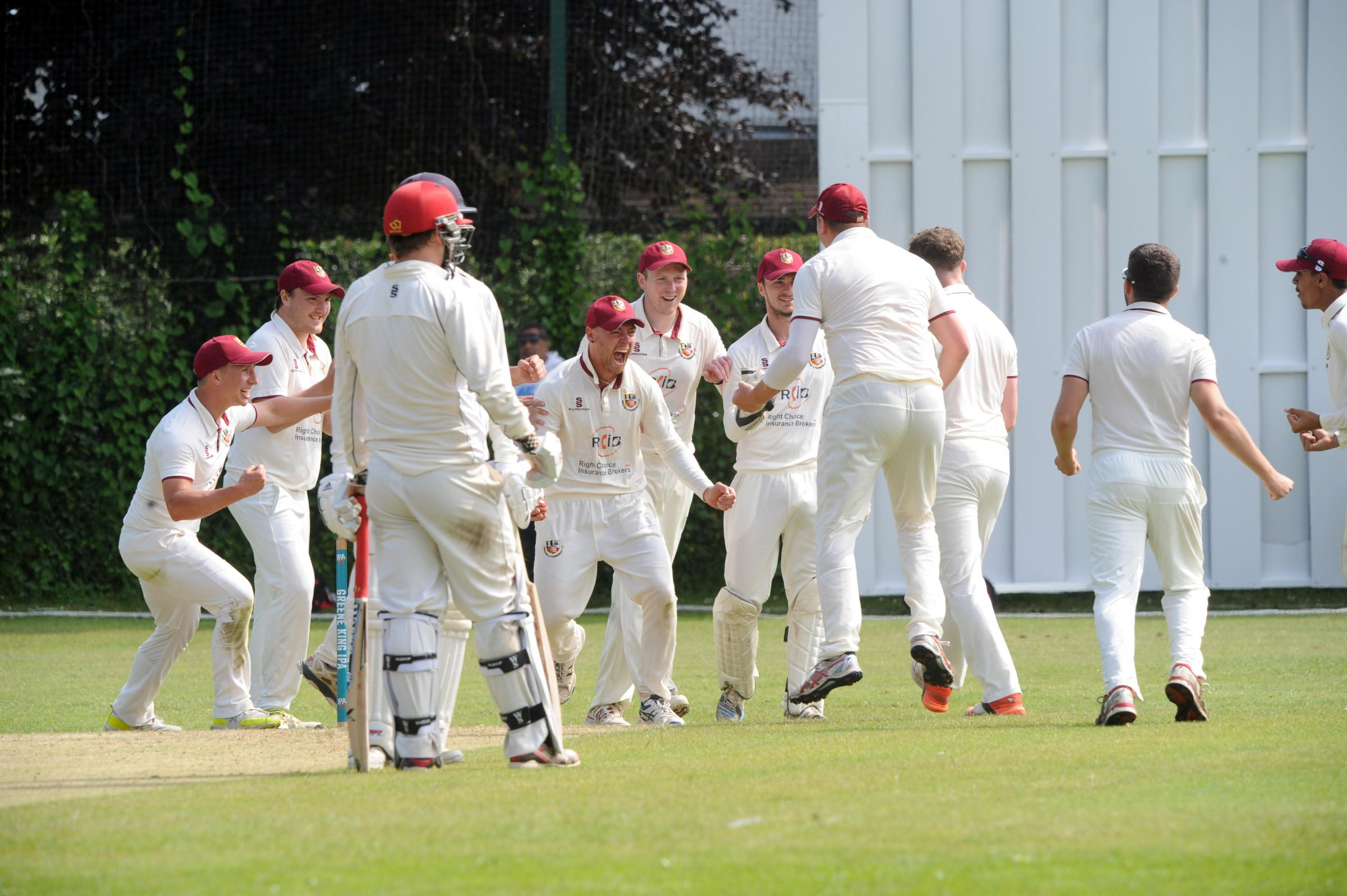 Scenes - Hadleigh & Thundersley celebrate a wicket in their recent win against Billericay Picture: JON WAGSTAFF
