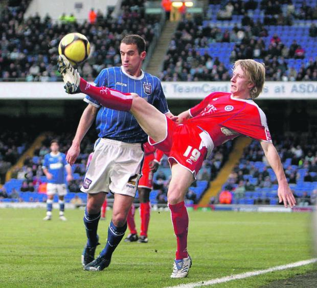 New signing - David Wright, left, seen here playing for Ipswich Town, has become Colchester United's latest signing.