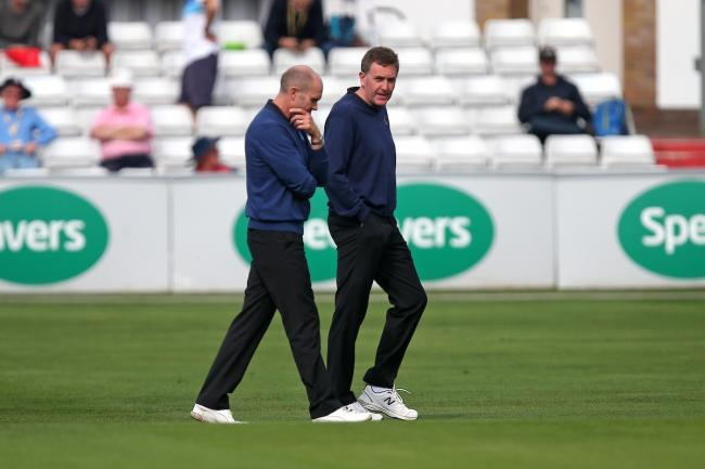 In conversation - umpires Rob Bailey and Mike Burns inspect the outfield during Essex v Hampshire at Chelmsford Picture: GAVIN ELLIS/TGS PHOTO
