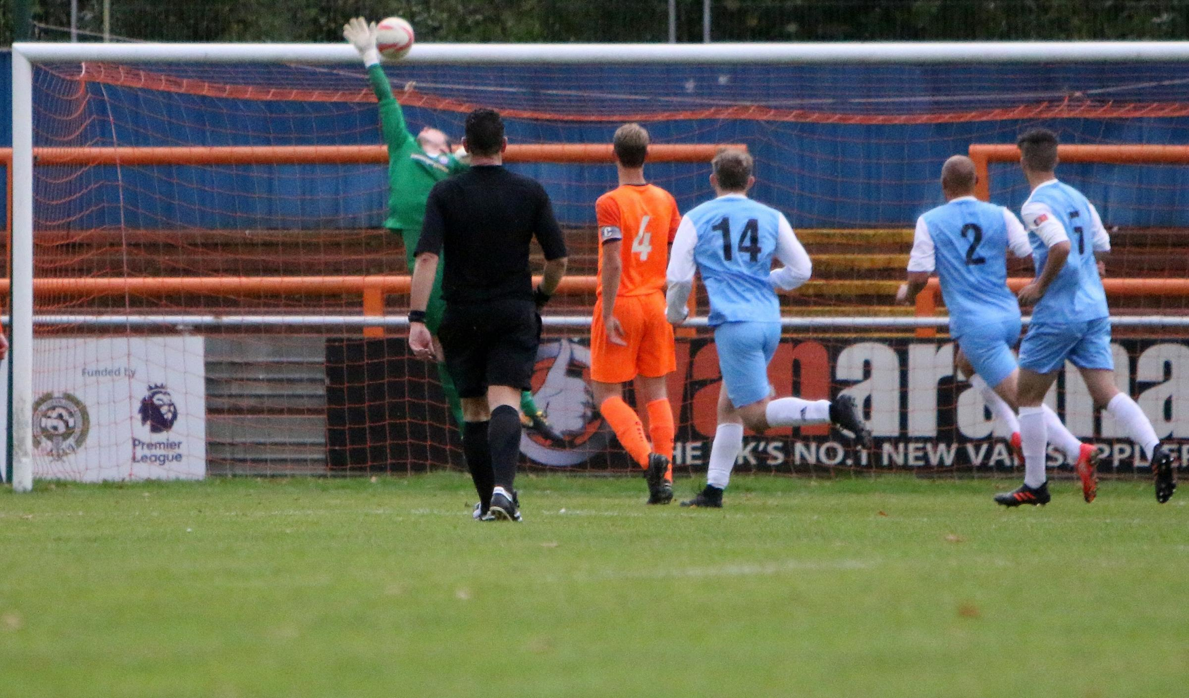 So close: Holland (wearing their blue change strip) are denied by the woodwork against Braintree Town Reserves.