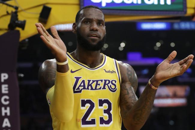 59bdb22740ef Los Angeles Lakers  LeBron James earned a triple-double alongside team-mate  Lonzo