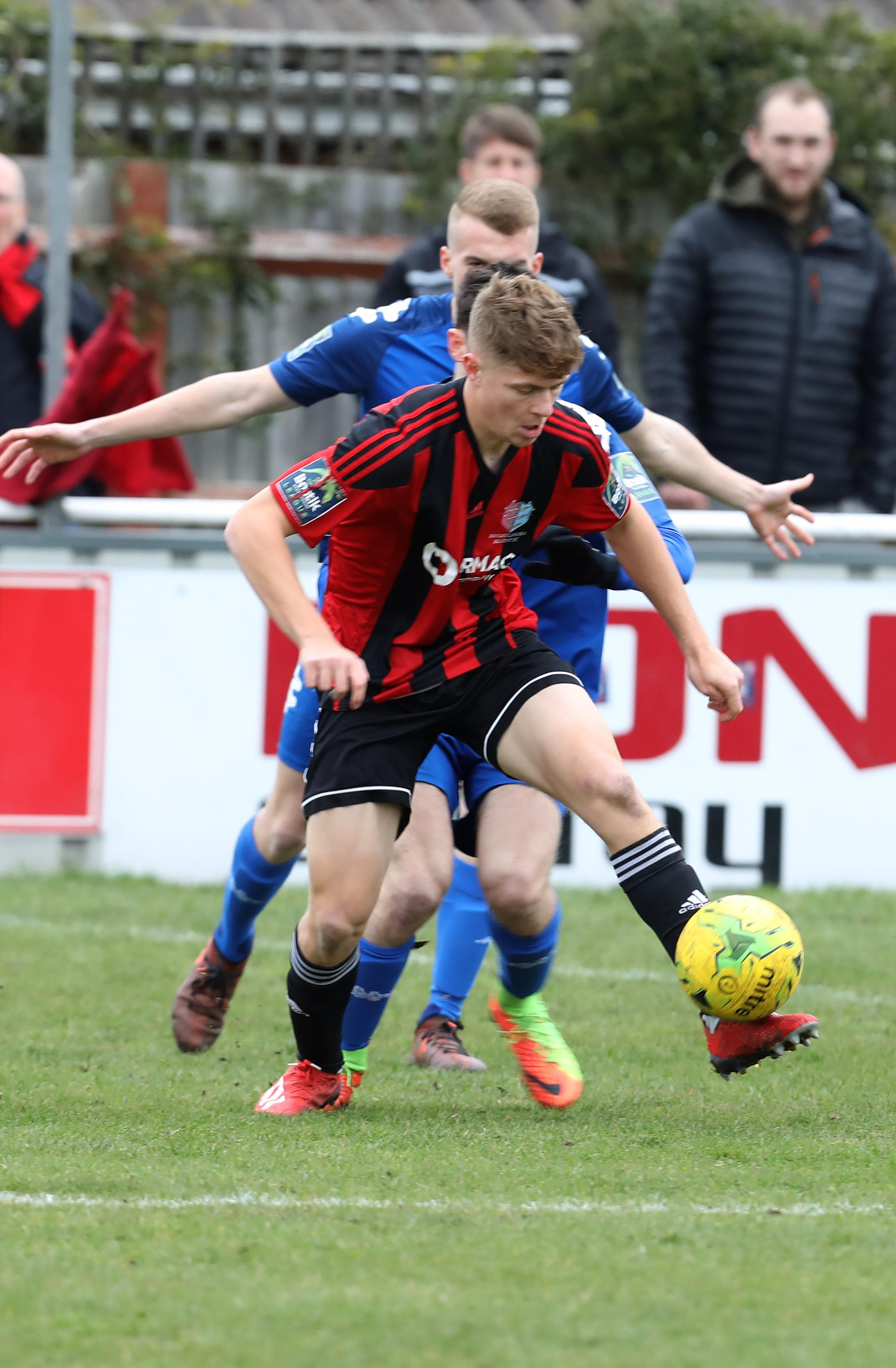 On the ball - Rob Harvey keeps an opponent at bay during Saturday's goalless draw against Lewes Picture: Steve Brading