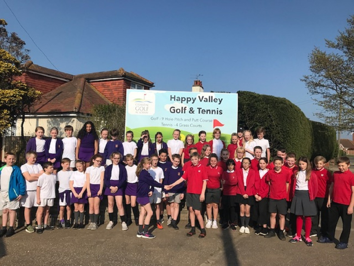 New skills: Pupils from Holland Park and Holland Haven schools received some top tips as they joined in the celebrations at Happy Valley Golf and Tennis.
