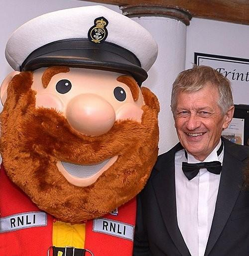Tribute - John Rayner with RNLI mascot Stormy Stan. Picture: RNLI/Stewart Oxley