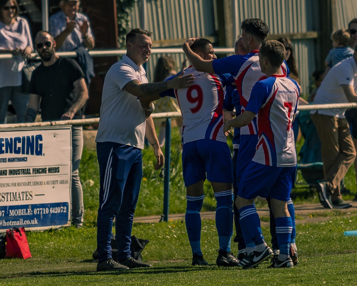 Party time: Clacton players celebrate with boss Tom Austin after scoring against Walsham-le-Willows on Saturday Picture: Rob Smith (RJS Photography)