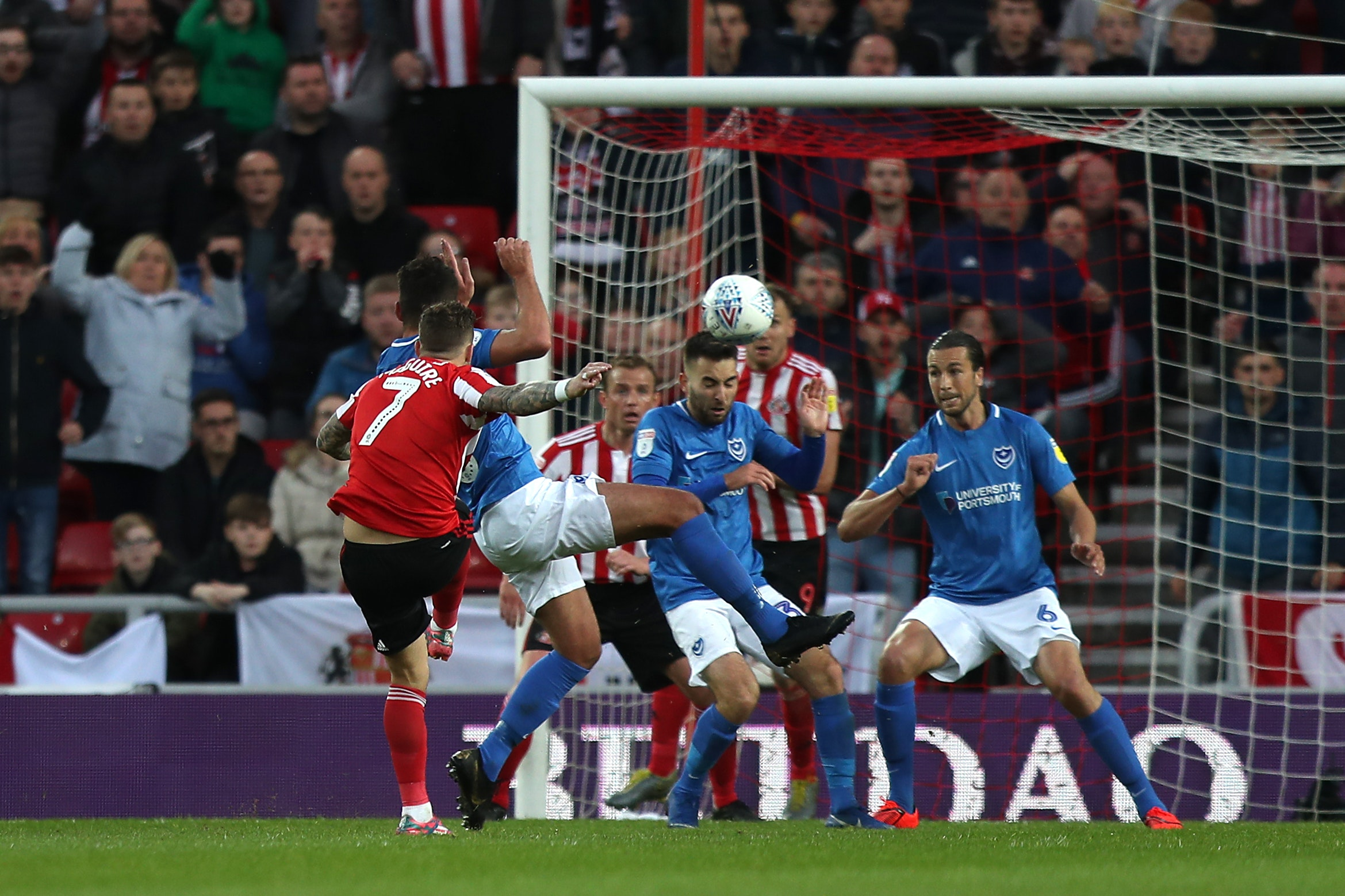 Chris Maguire (left) volleys Sunderland into a first leg lead over play-off rivals Portsmouth