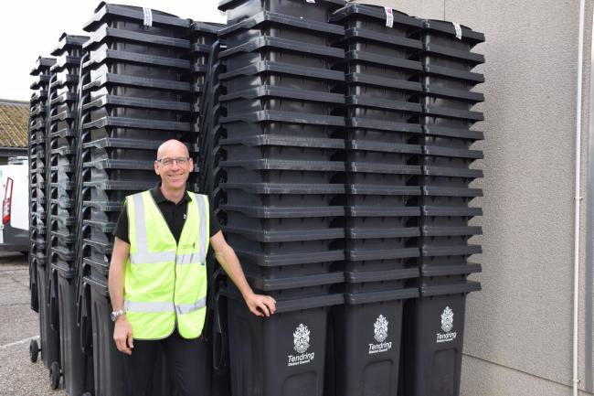 Tendring Council's Jon Hamlet with some of the new wheelie bins