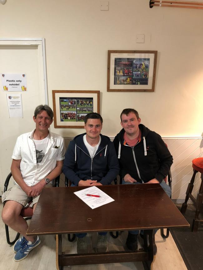 Key signing - striker Billy Hunt with chairman Terry Doherty (left) and secretary Tony Osborne. Picture: Neil Payne