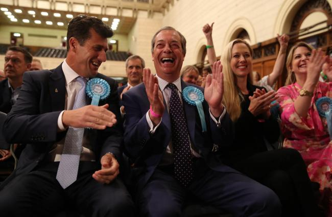 Brexit Party leader Nigel Farage (centre) celebrates being elected after the European Parliamentary elections count at the Guildhall in Southampton. Picture: Andrew Matthews/PA Wire