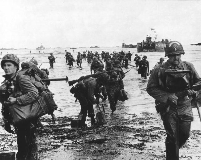 Undated handout photo of American troops wading ashore at Omaha Beach. See PA Feature NOSTALGIA D Day. Picture credit should read: James Holland/PA. WARNING: This picture must only be used to accompany PA Feature NOSTALGIA D Day..